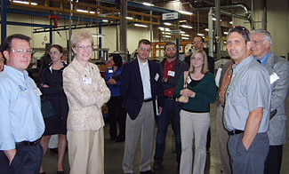 Participants visiting the new facility of Tyee Aircraft, a producer of aerospace components.  Tyee has incorporated sustainable principles into its lean manufacturing practices with zero waste water release, energy efficient lighting, and recycling programs.