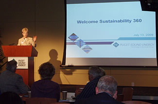 Mary Saunders giving her opening remarks for the Sustainability 360 event at utility Puget Sound Energy. PSE's 2008 energy efficiency work will result in annual savings for its customers of $30 million a year.