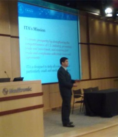 Gerry Zapiain explains ITA's mission to potential SME exporters of medical devices at NEI event in Minneapolis, Minnesota