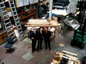 Left to right: Commercial Officer Douglas Wallace, Commercial Officer Andrew Wylegala, and Sculptor/Manufacturer, Capitano di Minuzie Nikolas Weinstein stand on the Weinstein Studios shop floor.