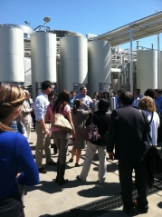 APEC delegates tour the grape crusher at Concannan Vineyard