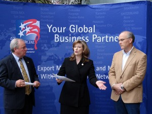 Lyn Doverspike (center), director of the Pittsburgh, Pennsylvania, Export Assistance Center, speaking at an Export Achievement Award ceremony for Cardinal Resources LLC. Exports account for close to 80 percent of the environmental services company's sales. Also attending the ceremony were Rep. Mike Doyle (right) and Kevin Jones, president of Cardinal Resources (left). (U.S. Department of Commerce photo)