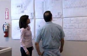 Kusum Kavia, chief operating officer of Combustion Associates Inc., reviews plans for an installation in Benin.