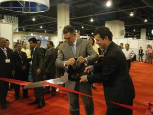 Francisco Sánchez, under secretary for international trade (left), and Chris DeMoulin, executive vice president of Advanstar Fashion Group and president of MAGIC International (right), cut the ribbon that officially opened the Sourcing at MAGIC show on August 22, 2011, in Las Vegas, Nevada. (photo courtesy U.S. Association of Importers of Textiles and Apparel)