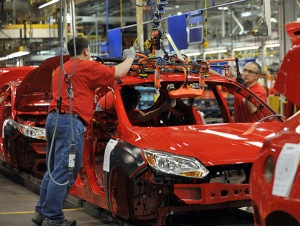 Ford Motor Company employees at the Michigan Assembly Plant in Wayne, MI assemble a 2012 Ford Focus.