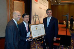 On October 18 in Hong Kong, Fred Lam (center), executive director of the Hong Kong Trade Development Council, was presented with the Peace through Commerce Award by Francisco Sánchez (right), under secretary of commerce for international trade. He was accompanied by Andrew Wylegala (left), senior commercial officer in Hong Kong. (U.S. Department of Commerce photo