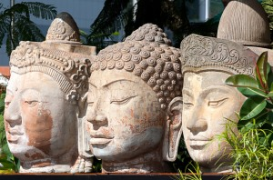 Three Buddha stone heads, Singapore. (© Hayden Bird/iStock)