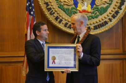 Secretary Bryson presents a Certificate of Appreciation for Achievement in Trade to Lieutenant Governor Brian Schatz recognizing the State's leadership in promoting the Hawaiian Islands as a destination for foreign travelers.