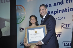 Under Secretary Francisco Sanchez presents the Peace through Commerce Award to Ms. Kiran Pasricha, former head of the Washington office of the Confederation of Indian Industry