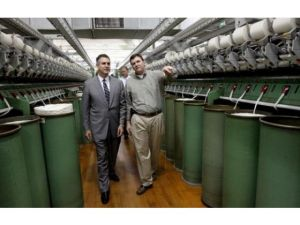Francisco Sanchez, under sectetary of commerce for international trade, left, listens to plant manager Keith Nicholson, right, as he toured Parkdale plant 15 in Belmont on Wednesday morning. (John Clark/The Gazette)