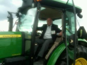 Peter Perez testing out a John Deere tractor. Built in Moline, IL, this $250,000 piece of equipment represents some of the most technologically advanced American manufactured machines in the industry.