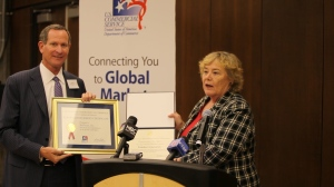 Congresswoman Zoe Lofgren presents Ron Sege, CEO of Echelon Corporation with the U.S. Commerce Department's Export Achievement Certificate.