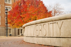 University sign in autumn
