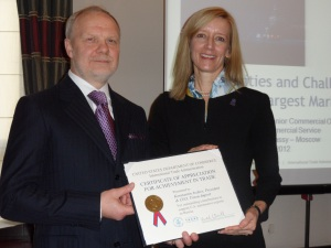 Deputy Under Secretary Michelle O'Neill presents a certificate of recognition to Konstantin Avdeev, President and CEO of Triton-Import for their support of U.S. exporters of automotive spare parts.