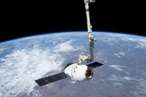 View from the International Space Station of the SpaceX Dragon spacecraft as the station's robotic arm moves Dragon into place for attachment to the station. May 25, 2012. Photo: NASA
