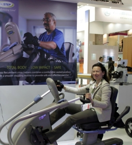 Elena Stegemann, International Business Manager for NuStep Inc. operating one NuStep's machines at Arab Health 2012 (Photo NuStep, Inc.)
