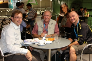 Gerd Klose, Managing Director of DeFeet's distributor in Germany Lynn Moretz, VP International Sales and Shane Cooper, founder of DeFeet display their products during the Eurobike show in Friedrichshafen, Germany. (Photo DeFeet)