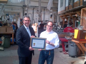 Under Secretary Francisco Sánchez presents Nikolas Weinstein of Nikolas Weinstein Studios an Export Achievement Certificate at his studio in San Francisco (Photo Commerce)
