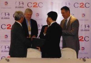 Under Secretary Sánchez (top right) witnesses a signing ceremony where American company GE will provide renewable energy technology to a Cambodian firm, SOMA Group. Representatives from both GE and SOMA were on hand for the event