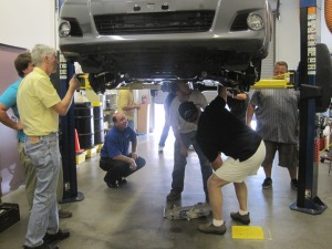 SEMA members inspect the Toyota HiLux during a recent measuring session held in California. (Photo Commerce)