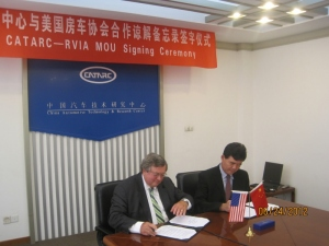 RVIA President Richard Coon signs CATARC agreement. (Photo RVIA)
