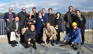 International Trade Administration and Department of Energy employees pose for a photo with trade mission participants and workers from the Tohoku Electric Utility on an observation platform above Matsushima Bay in Japan in December 2012.
