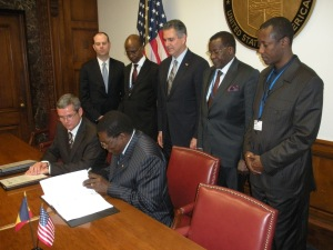 Jean-Marc Teleu and Chadian Abassador to U.S.HIS EXCELLENCY MAITINE DJOUMBE sign a contract to export 500 John Deere agricultural tractors to Chad