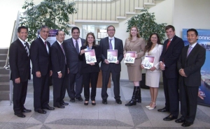 "The inaugural Spanish language version of the Trade Finance Guide was released at the May 8 ""Trade Connect"" workshop held at the Los Angeles Area Chamber of Commerce. From right to left: Yuki Fujiyama of ITA, Hon. Sean Mulvaney of Ex-Im Bank, Cheryl Hines of Keylingo Translations, Bronwen Madden of CITD, Paul Thanos of ITA, Marta Chacon of FCIB, Diego Jiménez of FCIB, Norman Arikawa of the Port of LA, Carlos Valderrama of the LA Area Chamber, and Sergio Gascon of the MBDA Business Center."