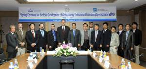 Representatives from Ball Aerospace and the Korean Aerospace Research Institute signed their business contract during the Trade Winds Asia 2013 trade mission.