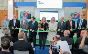 Chandra Brown, center, joins members of the Commercial Alternative Aviation Fuels Initiative to cut the ribbon at the Alternative Aviation Fuels Pavilion at the Paris Air Show.