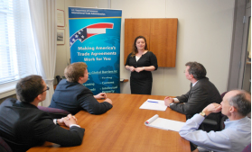 Emily King gives a presentation to members of the staff of the Trade Compliance Center.