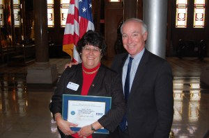 Anne Evans and Rep. Joe Courtney (D-CT) pose after Evans was awarded the Department of Defense Reservist and Guard Patriot Award.