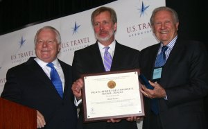 Werner Escher, far right, receives the Peace Through Commerce Medal Award from Deputy Under Secretary Ken Hyatt at the IPW Tourism Summit in June 2013. At far left, Roger Dow, President of the U.S. Travel Association.