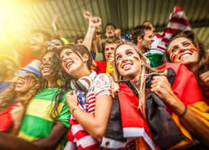 Fans from many countries watch a sporting event.