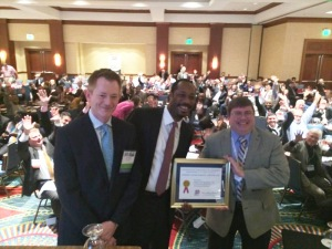 ITA's Eric Johnson (left) and Antwaun Griffin (center) presented Jeff Carson from House of Cheatham with an Export Achievement Certificate in 2014 to honor the company's growth in international business.