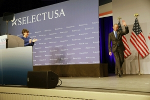 U.S. Secretary of Commerce Penny Pritzker greets President Barack Obama at the 2015 SelectUSA Investment Summit.