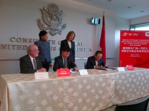 Commerce Secretary Penny Pritzker and Deputy Secretary of Energy Elizabeth Sherwood-Randall witness the signing of an agreement between Cummins, Inc., and the Guangzhou No. 1 Public Transit Co., during the Smart Cities-Smart Growth trade mission stop in Guangzhou, China, on April 17.