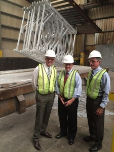 Photo of Fred Hochberg and two unidentified men in hard hats, safety vests and ties.