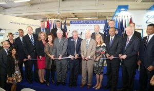 Assistant Secretary of Commerce for Industry & Analysis Marcus Jadotte, Secretary of the Air Force Deborah James, U.S. Ambassador to France Jane Hartley, Senators Shelby and Cochran, and many other distinguished visitors join Tom Kallman, President and CEO of Kallman Worldwide, with the ribbon cutting ceremony that opened the U.S. International Pavilion at the 2015 Paris Air Show