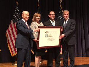 U.S. Secretary of Commerce Wilbur Ross presents an E Star Award to Johnsonville for growing their exports by 233% since 2008.