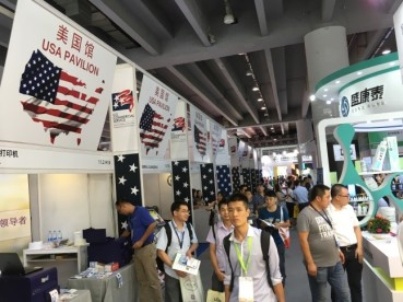 Attendees tour the USA Pavilion at the Guangzhou International Lighting Expo (GILE) trade show, where there was record high attendance at this ITA Trade Fair Certified event.