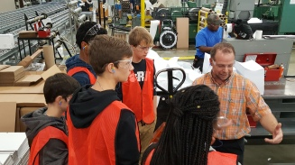 An employee of UK-based manufacturing company Domtar provides high school students with a tour of the company's facility in Rock Hill, S.C. on Oct. 6.