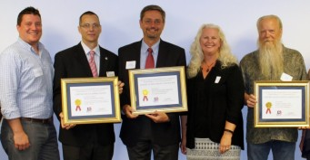 U.S. Rep. Kilmer's District Representative Nicholas Carr presented each of the three organizations with their Certificate of Appreciation at a recent event hosted by the World Trade Center Tacoma. L-R: Nicholas Carr, James Newman of Tacoma Community College, Dennis Morris of SAFE Boats International, Diane Mooney of U.S. Commercial Service Seattle, Jason Lollar of Lollar Guitars, Inc.