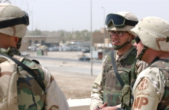 U.S. Army Segeant Chris Higginbotham standing with comrades in Iraq in 2004.
