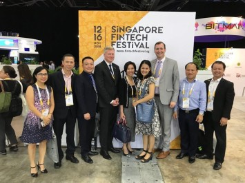 Deputy Assistant Secretary for Services James Sullivan (fourth from left) is joined by U.S. Commercial Service staff at the November 2018 FinTech Festival in Singapore.